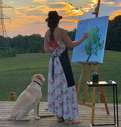 Nancy Joyce painting on a farm